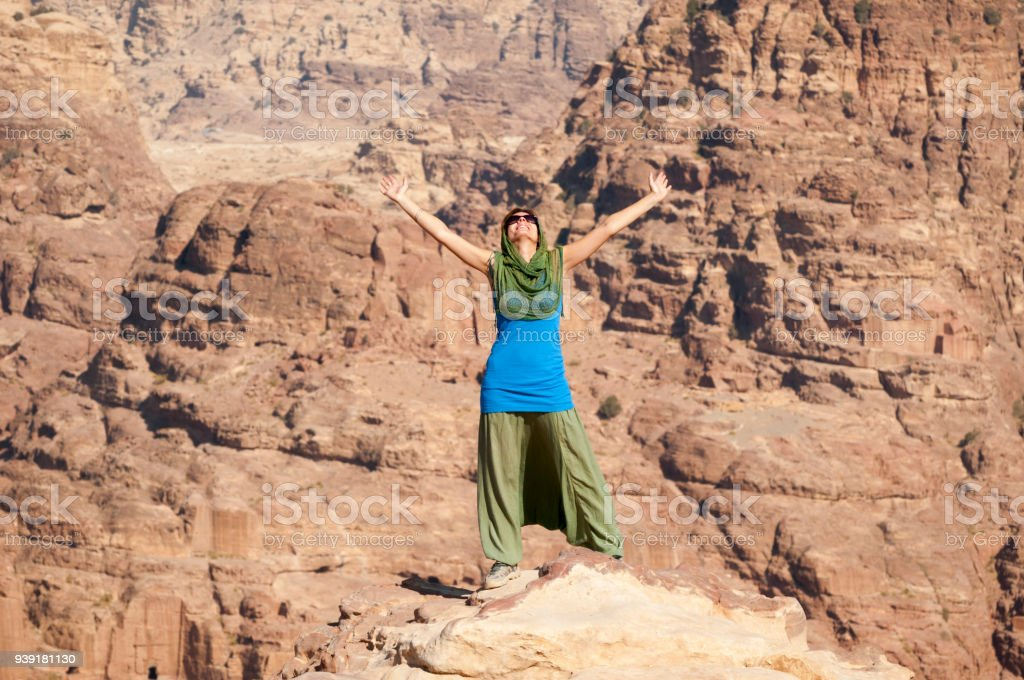 uk availability 72c2d 0da61 Woman with arms outstretched on mountaintop (Petra, Jordan) royalty-free  stock photo