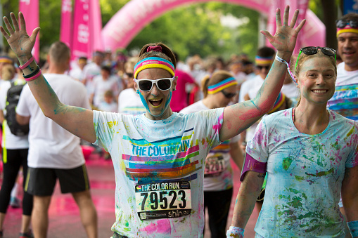 istock Woman with arms raised celebrating, The Color Run Event Seattle 473259618