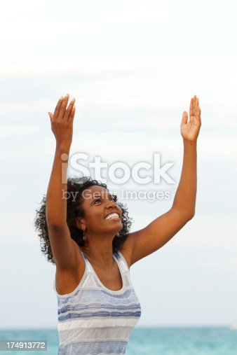 508455188 istock photo Woman with arms raised 174913772