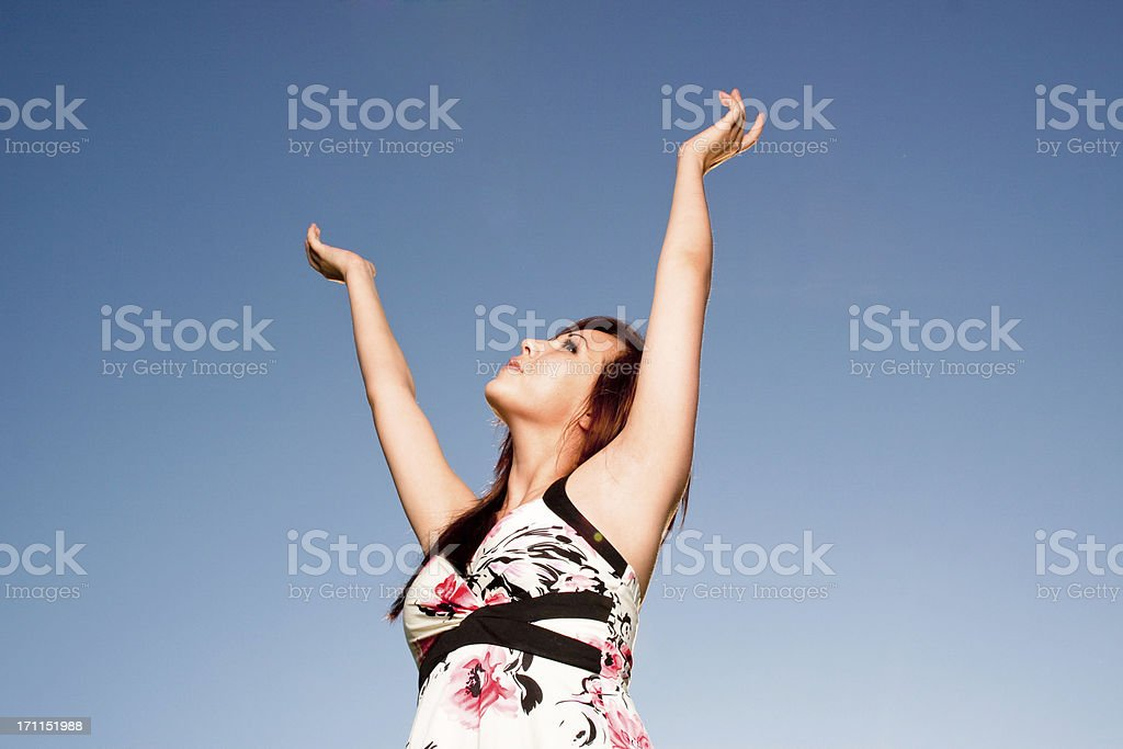 Woman with arms raised up royalty-free stock photo