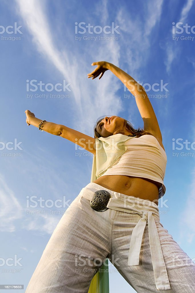 Woman with arms up stock photo