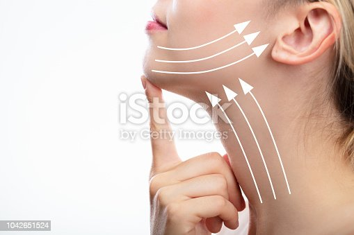 istock Woman With Arrows On Her Face 1042651524