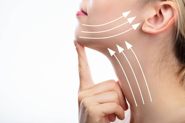 Woman With Arrows On Her Face Woman With Arrows On Her Face Over White Background retrieving stock pictures, royalty-free photos & images