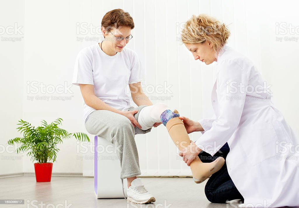 Woman with Artificial Limb at doctors office royalty-free stock photo