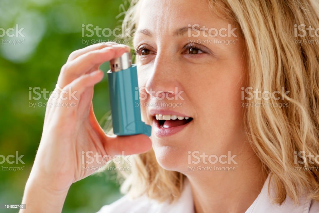 Woman With Asthma Inhaler Outdoor royalty-free stock photo