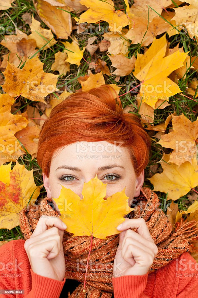Woman with autumn leaf stock photo