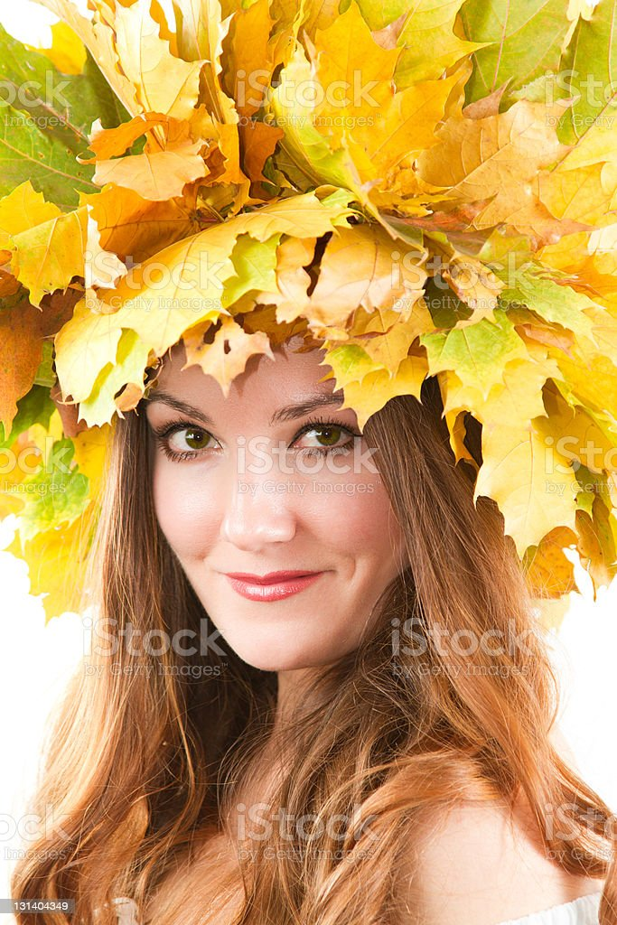 woman with autumn wreath of maple leaves royalty-free stock photo