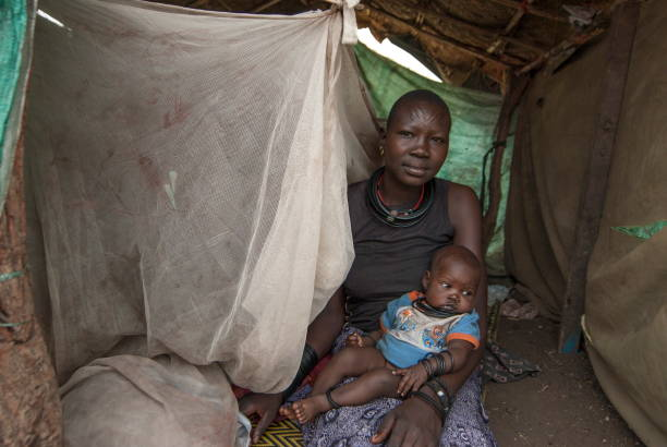 Woman with baby in displaced persons camp, Juba, South Sudan. stock photo