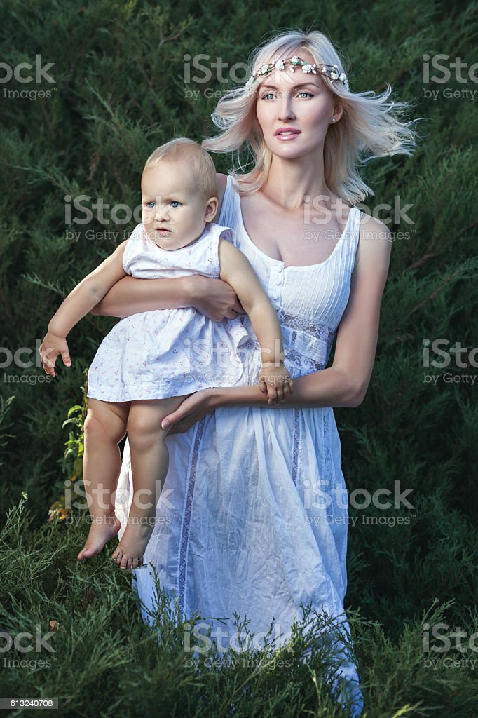 Woman with baby in her arms. stock photo