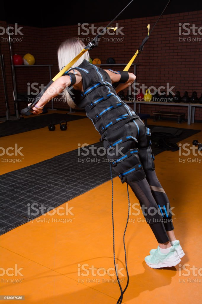Woman with back in Electrical Muscular Stimulation stock photo