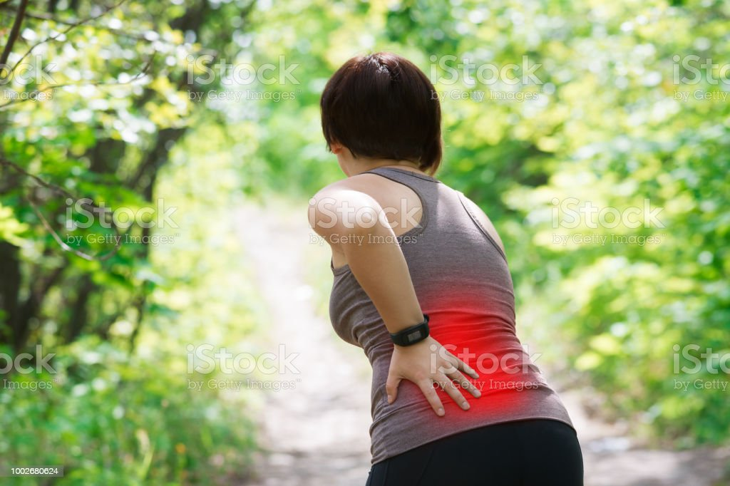 Woman with back pain, kidney inflammation, injury during workout,...