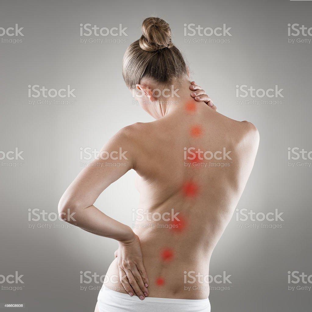 Frau mit Rückenschmerzen Lizenzfreies stock-foto