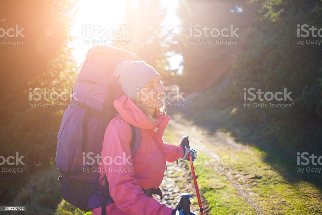 Woman with backpack in forest. royalty-free stock photo