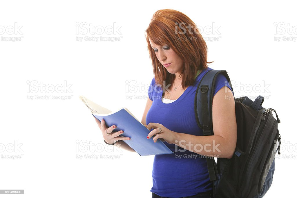 woman with backpack reading royalty-free stock photo