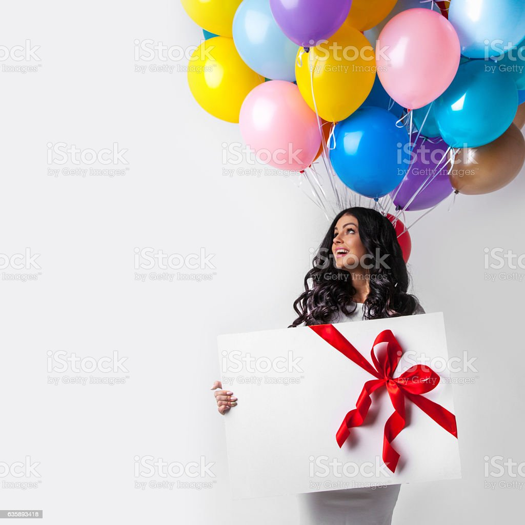 Woman with balloons and gift stock photo