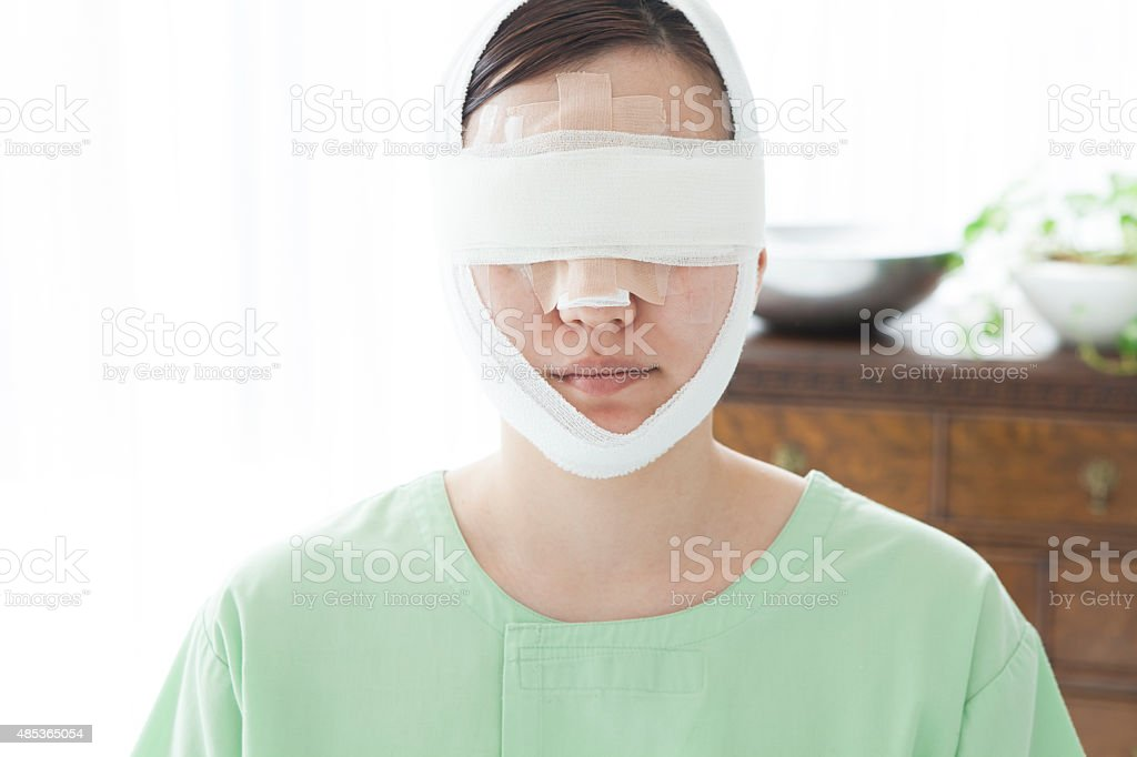 Woman with bandages around head