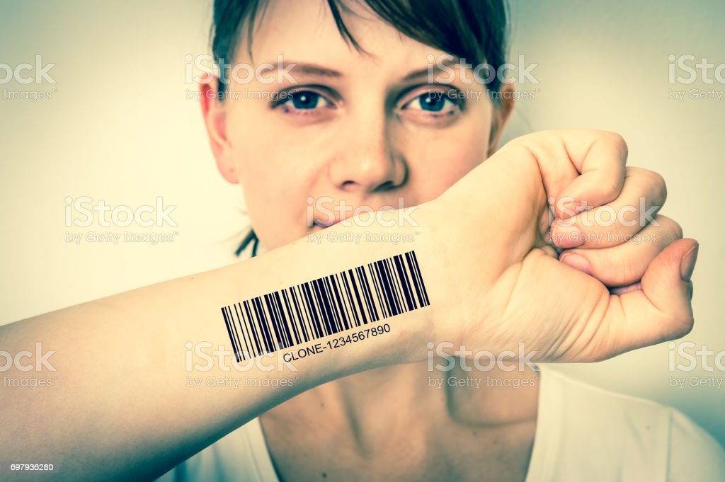 Woman with barcode on her hand - genetic clone concept stock photo