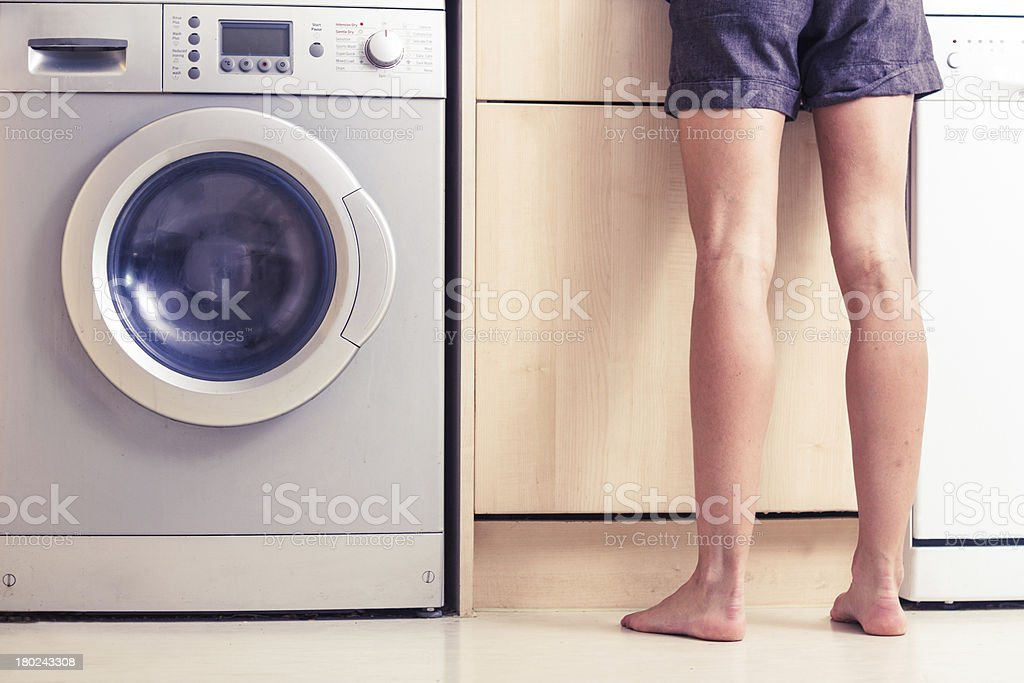 Woman with bare legs in kitchen royalty-free stock photo