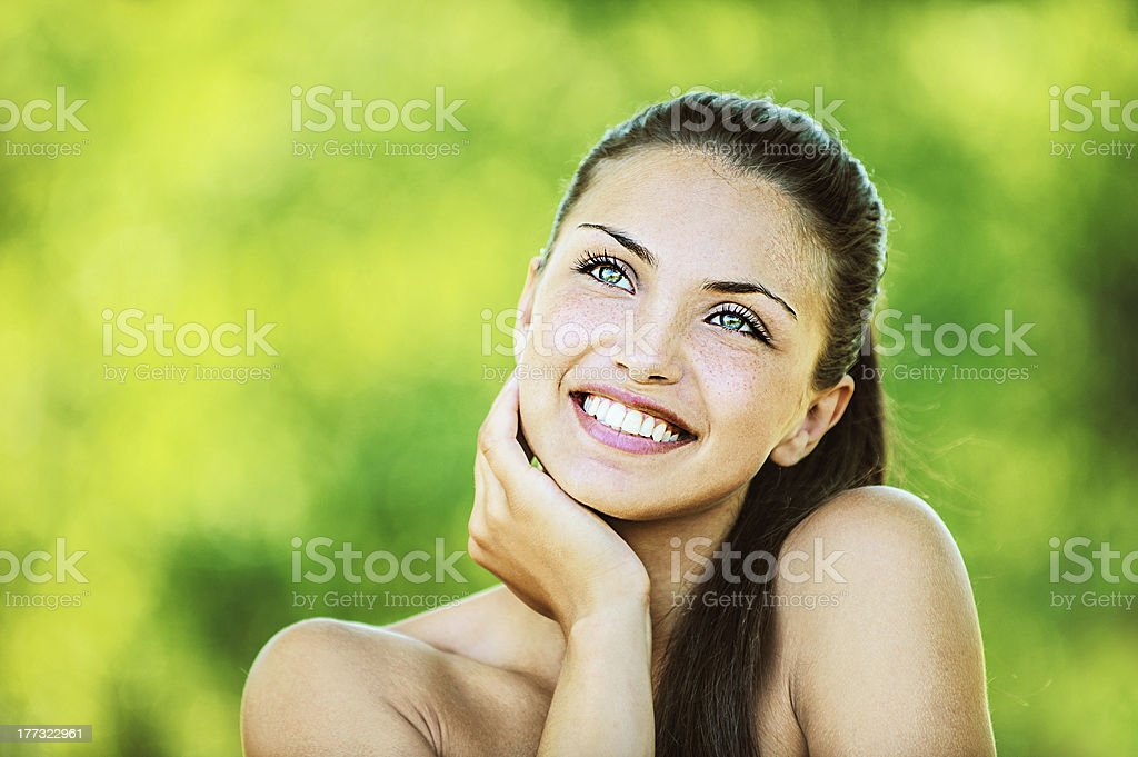 woman with bare shoulders laughs and looks up royalty-free stock photo
