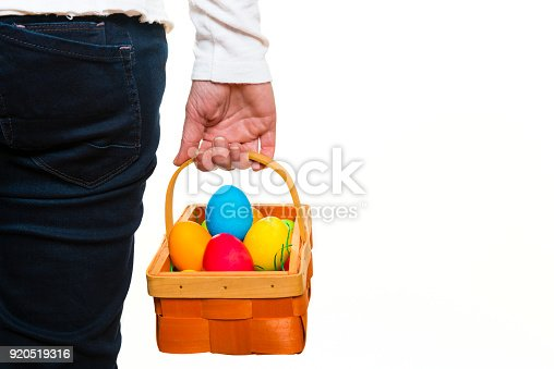 woman with basket full of easter eggs