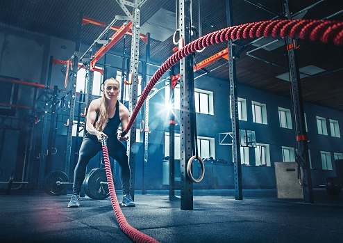 woman with battle rope battle ropes exercise in the