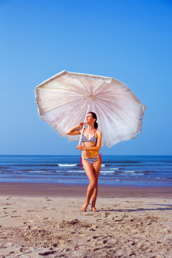 Woman With Beach Umbrella Stock Photo - Download Image Now