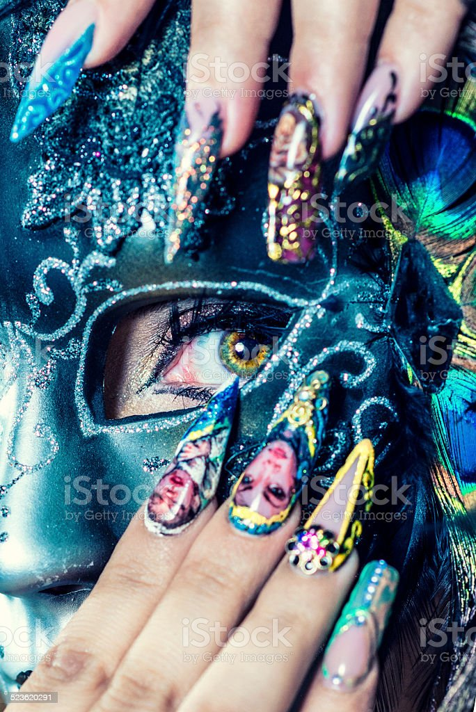 Woman with Beautiful Manicure Nail Gel Art and Venetian Mask. Studio...