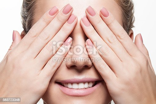 Woman with beautiful natural manicure and perfect clean skin on white background