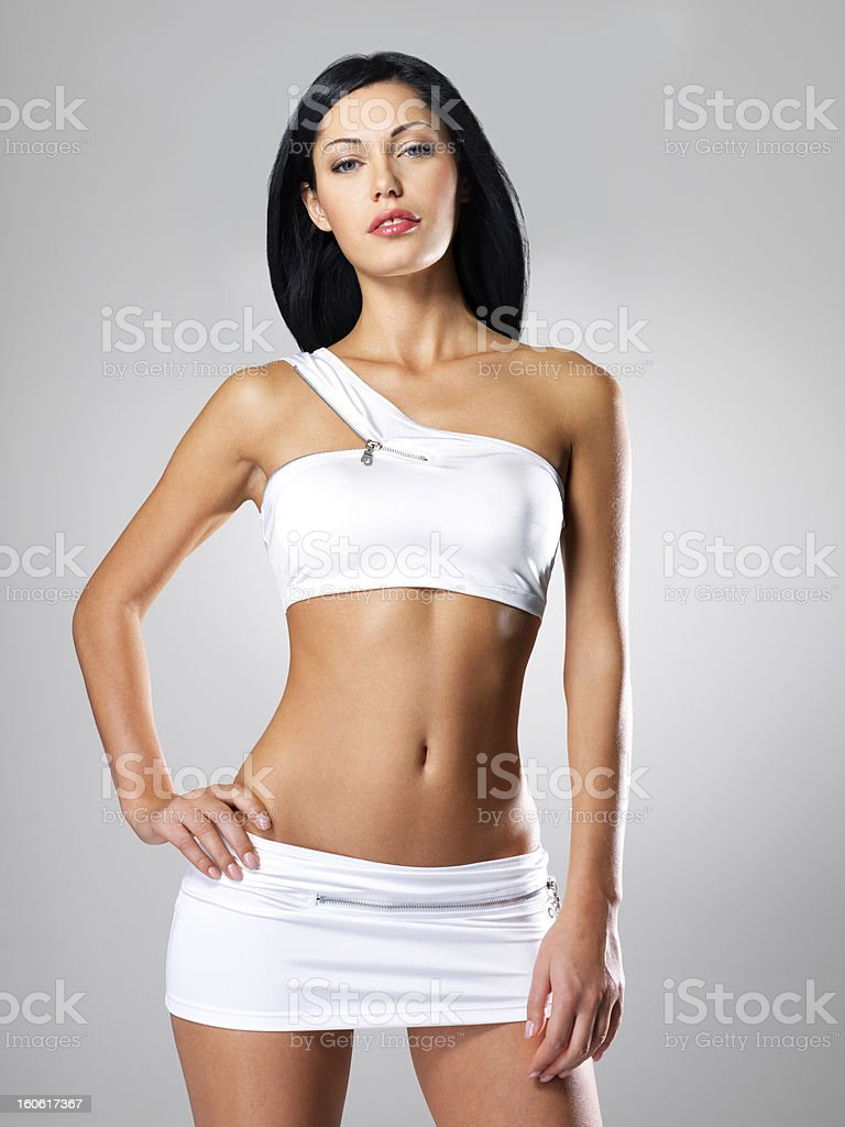 Woman with beautiful slim tanned body stock photo