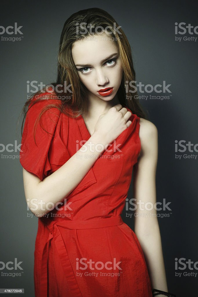 Woman with beauty make-up and red dress royalty-free stock photo