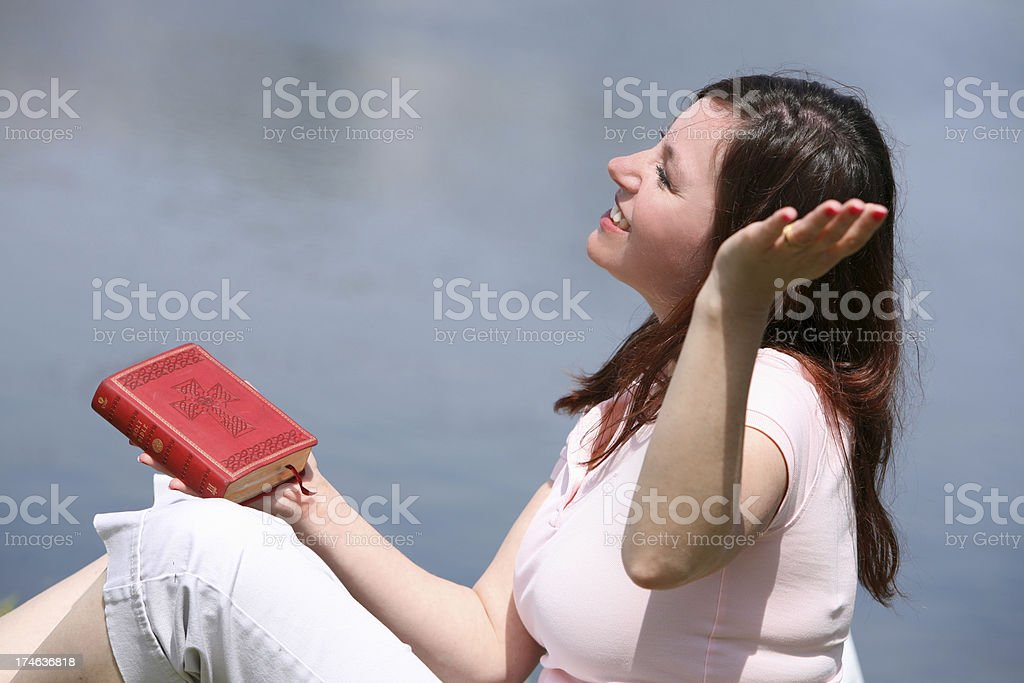 Woman with Bible. Praising God. stock photo