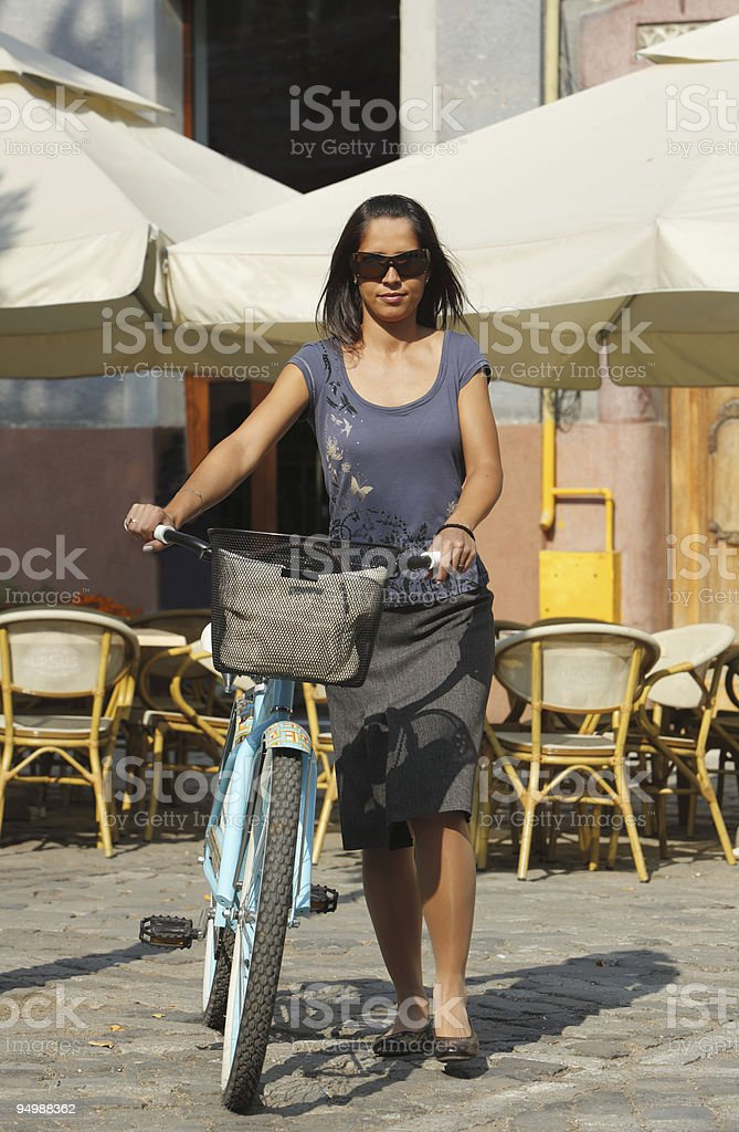 Woman With Bicycle In A City royalty-free stock photo