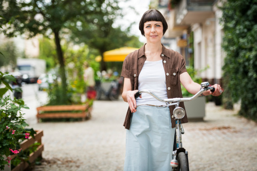 Woman with Bicycle in Berlin, Germany