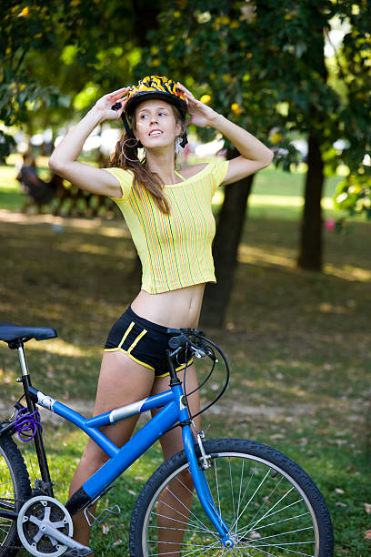 woman with bicycle - mountain biking stock photos and pictures