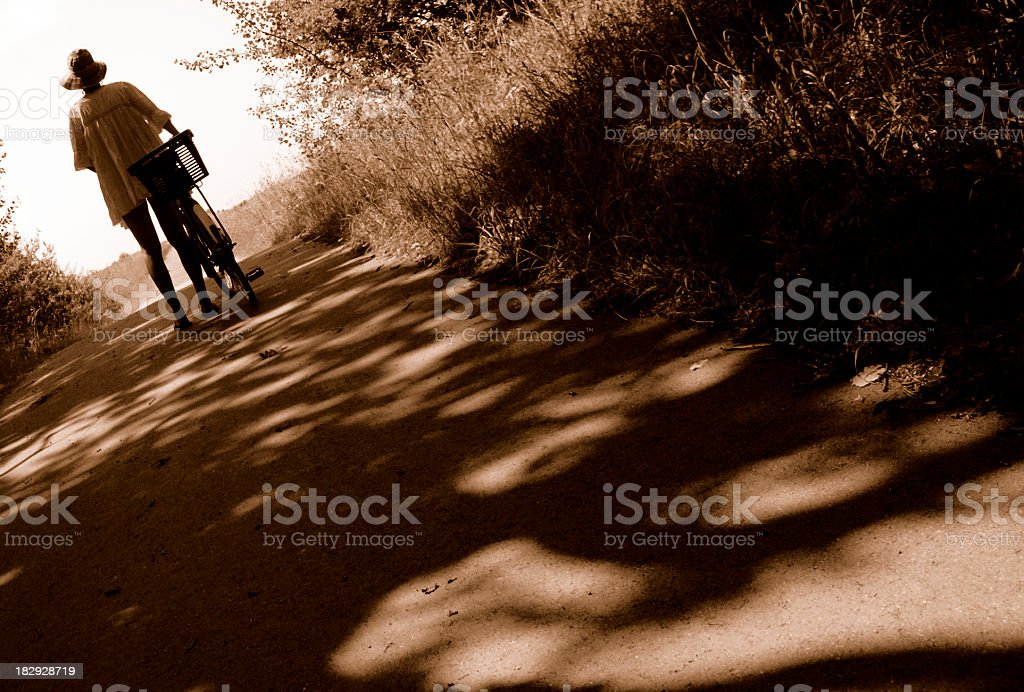 Woman with bicycle royalty-free stock photo