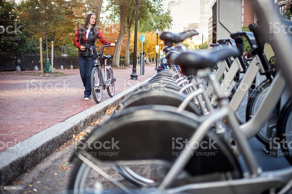 Woman with bicycle stock photo