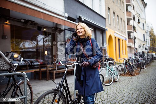 Woman With Bicycle Talking On Phone In City Stock Photo & More Pictures of 45-49 Years