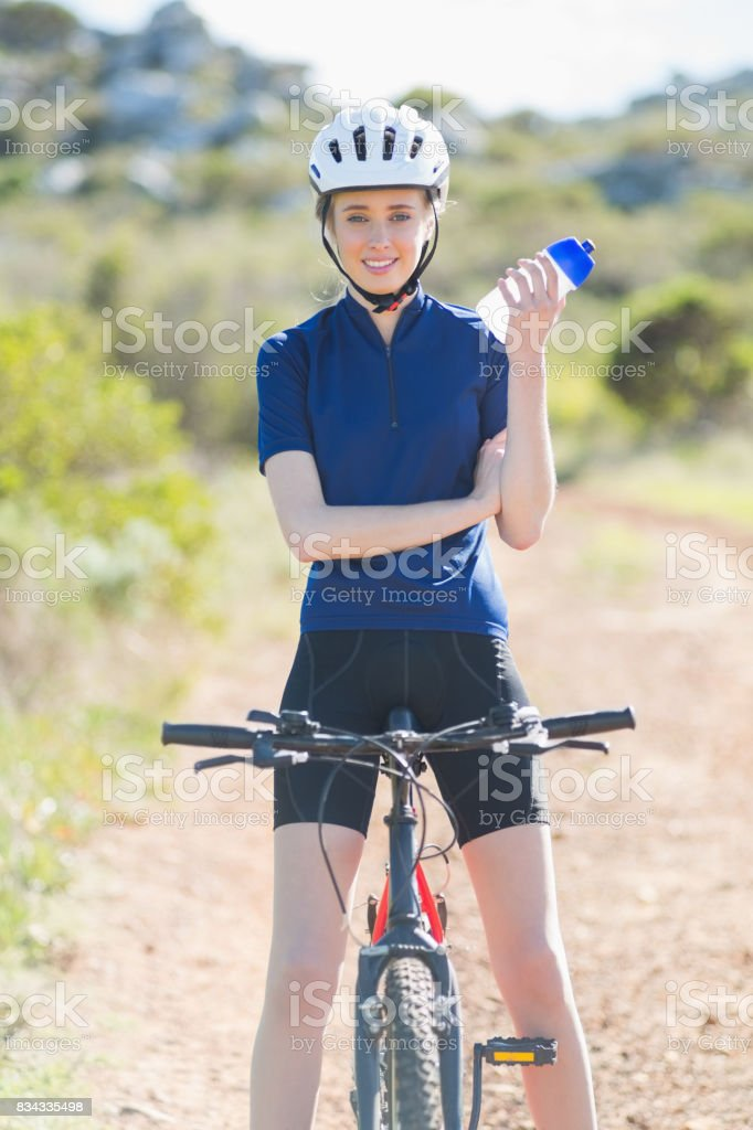 Woman with bike holding bottler stock photo