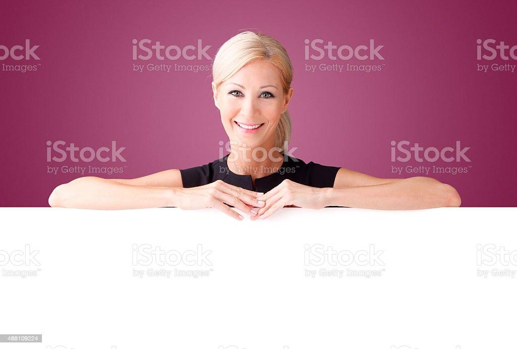 Woman with billboard stock photo
