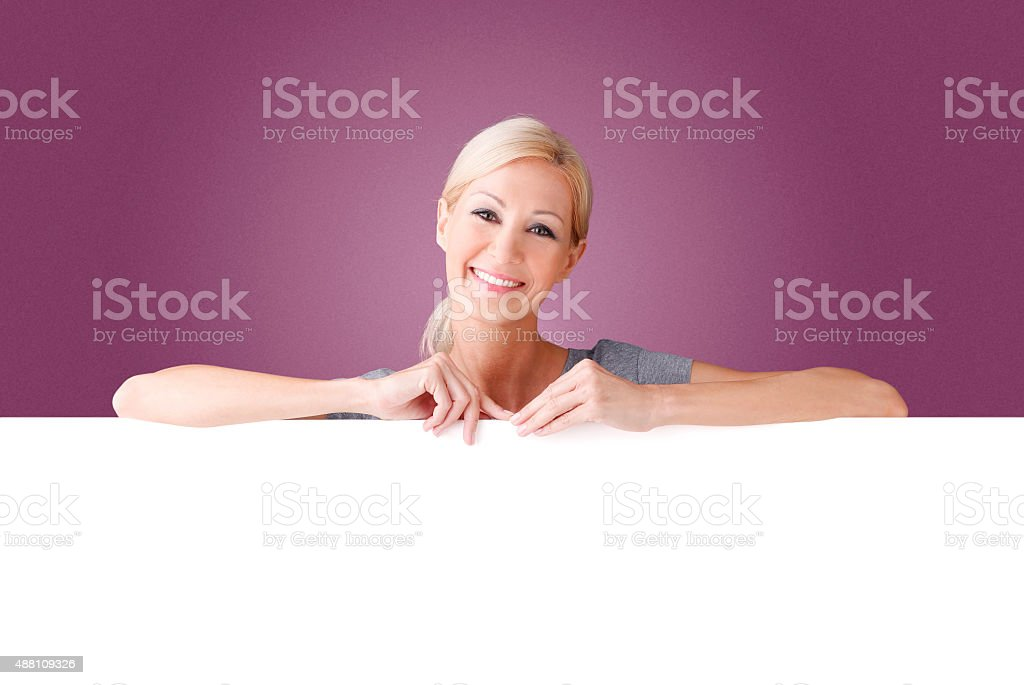 Woman with billboard stock photo