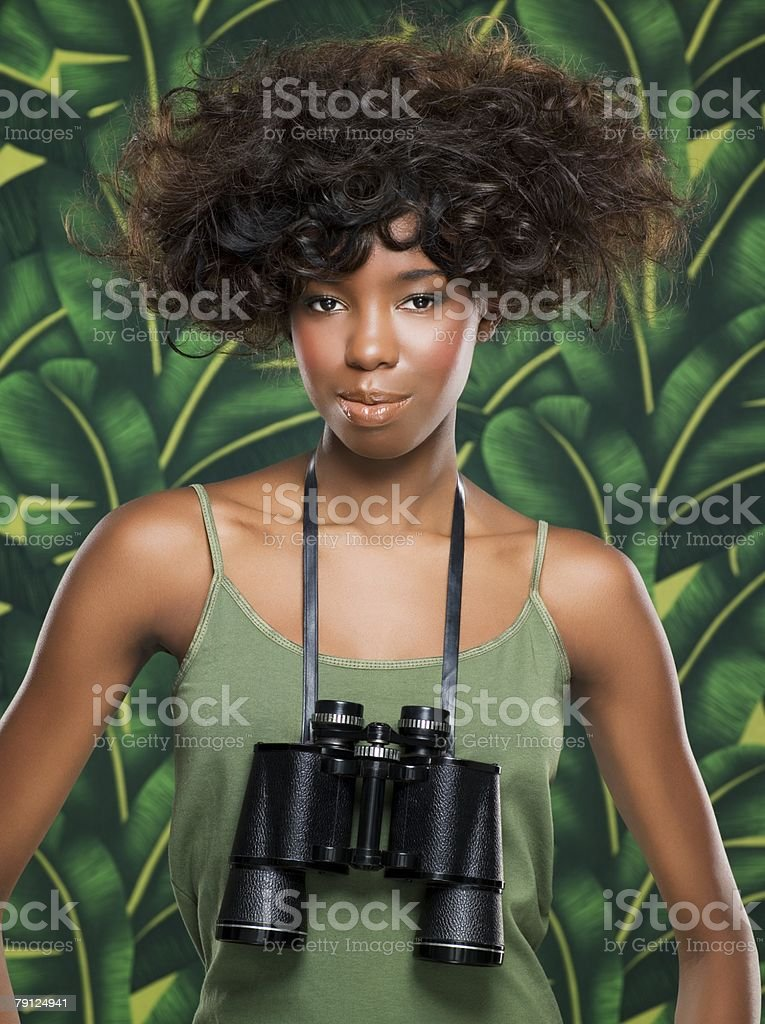 Woman with binoculars around her neck 免版稅 stock photo