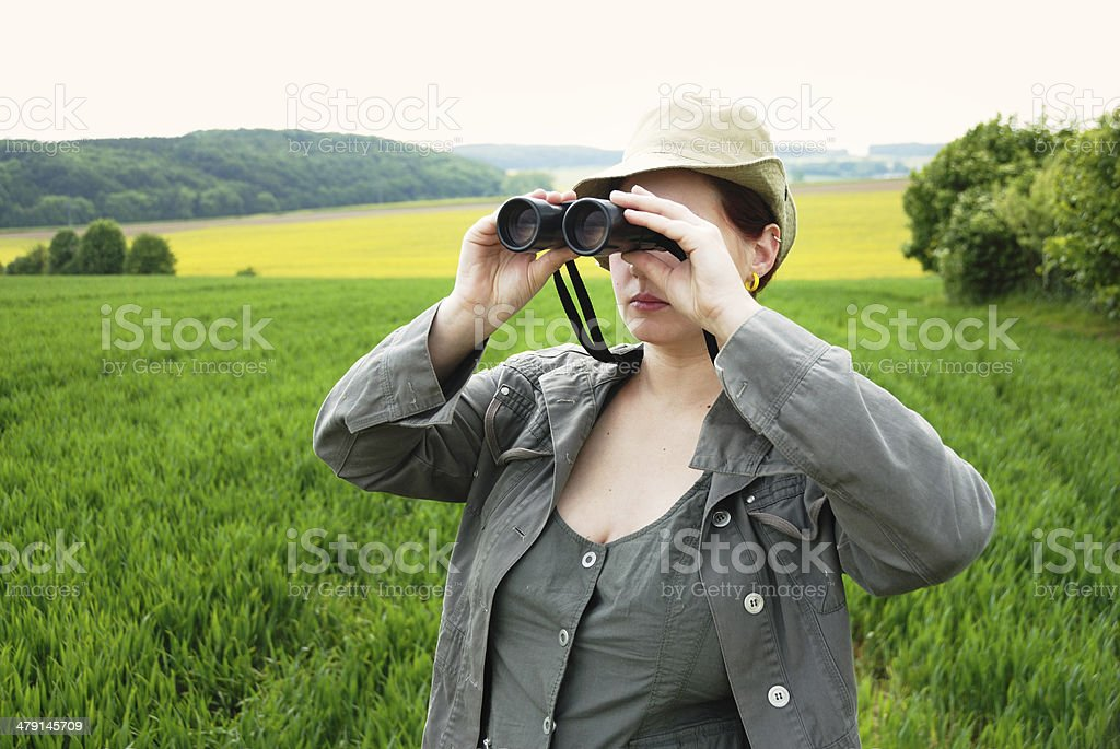 woman with binoculars royalty-free stock photo