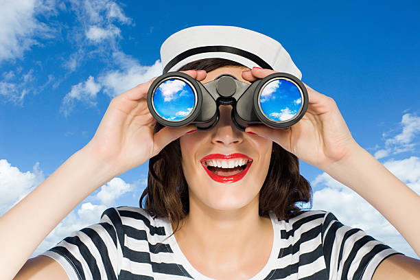 Woman with binoculars  sailor hat stock pictures, royalty-free photos & images