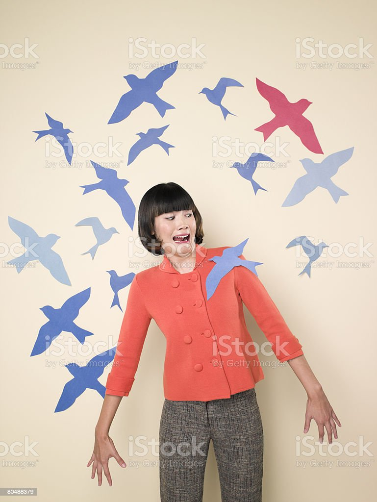 Woman with bird on her shoulder royalty-free stock photo
