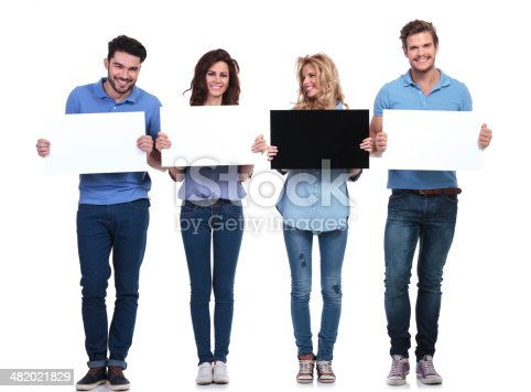 istock woman with black card looking to her side to friends 482021829