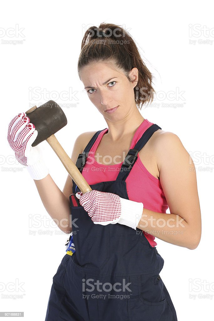 woman with black rubber mallet royalty-free stock photo