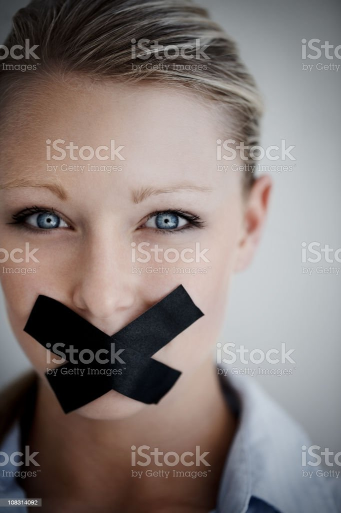 Woman with black tape on mouth representing no speech royalty-free stock photo