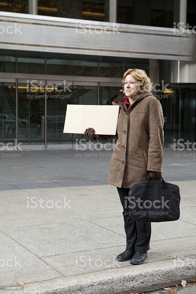 Woman with blank sign royalty-free stock photo