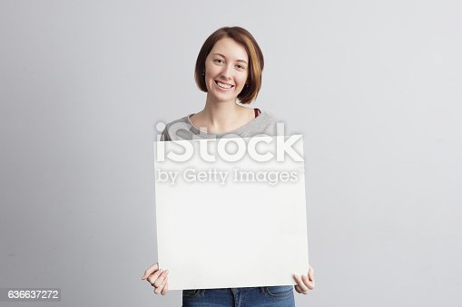 istock Woman with blank white card for text 636637272
