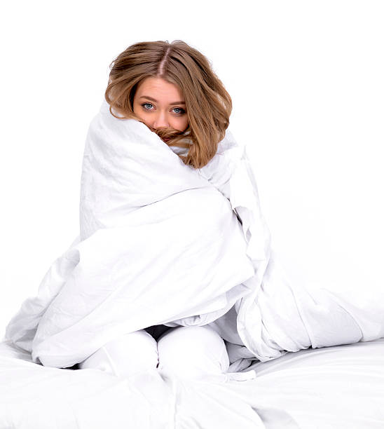 woman with blanket on her woman portrait being colf having blanket on her. wrapped in a blanket stock pictures, royalty-free photos & images